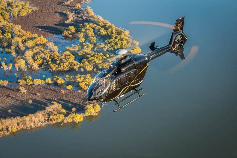 helicopter financing - flying over water